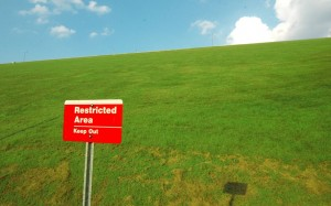 Image of a sign saying restricted area